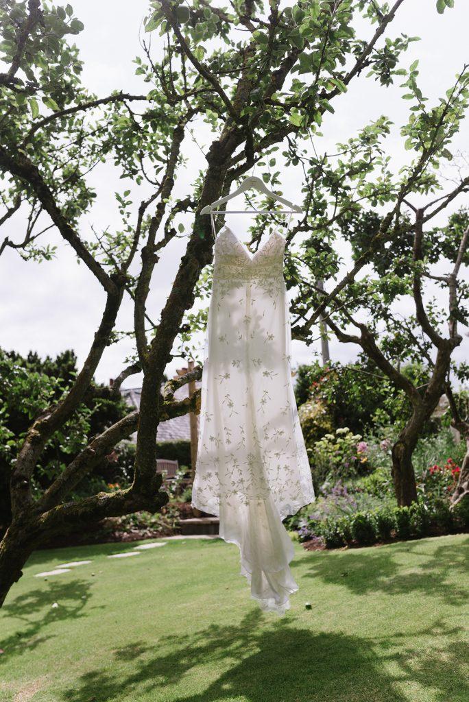 wedding dress hanging up in tree