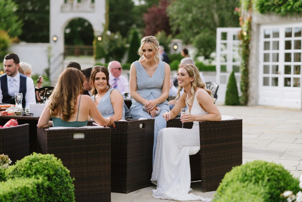 bride and friends casually chatting at Castle Bellingham, Louth, Ireland