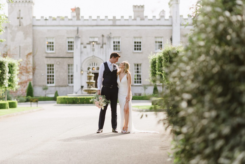 bride and groom at castle bellingham wedding venue