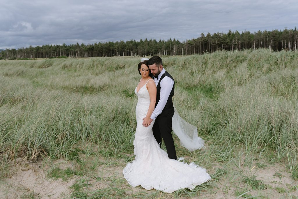 bride and groom on beach donegal