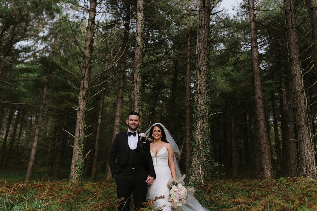 bride and groom in woods donegal
